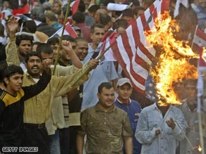 Demonstrators burn an American flag at a rally in Baghdad, Iraq, on Thursday.