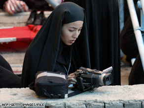 Journalist Roxana Saberi, shown working in Iran in 2004, is accused of spying in the country.