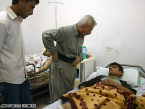 A man lies in a hospital after a roadside bombing near Kirkurk on Saturday. Three Iraqis were killed.