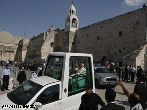 Pope Benedict leaves the Church of Nativity in his pope mobile after celebrating Mass Wednesday in Bethlehem.