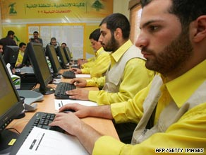 Hezbollah party workers in the southern town of Nabatiyah in anticipation of the elections on Sunday.