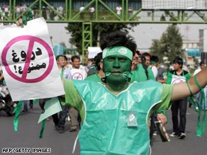 A Mousavi supporter holds a sign reading in Farsi 'Lying is Forbidden' during a street rally in Tehran.