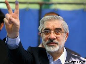 Presidential candidate Mir Hossein Mousavi holds up the 'V' sign after casting his vote on Friday.