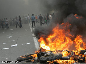 Supporters of defeated Iranian presidential candidate Mir Hossein Mousavi protest in Tehran on June 13, 2009.