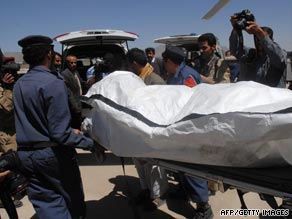 Yemeni military and medical staff carry the body of one of three killed hostages found in northern Yemen.