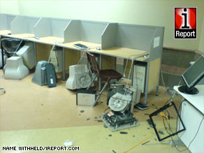 The aftermath of anti-riot police actions at Tehran University shows smashed computer terminals.