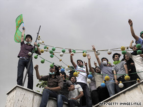 Students rally atop a building Monday on the campus of Tehran University.