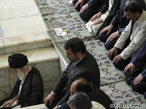 Iran's Grand Ayatollah leads Friday prayers with President Ahmadinejad behind him (whte jacket).