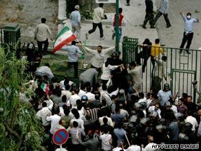 Members of the Basij militia enter Tehran University, where students were protesting on Monday.