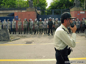Riot police form a line during a protest outside the British embassy in Tehran on June 23.