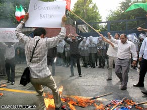 Students are shown burning British and U.S. flags outside the British embass in Tehran last week.