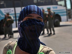 A Bedouin Arab girl protests near an Israeli police roadblock on the outskirts of Rahat in Israel on Sunday.