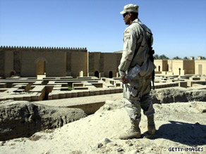 An U.S. soldier looks over the ancient city of Babylon in Iraq in 2004.