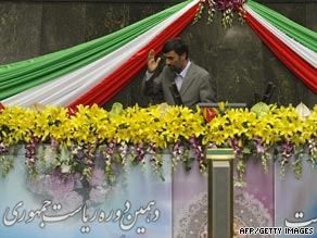 Ahmadinejad waves after being sworn in as Iranian president for a second time.
