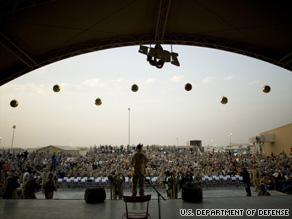 Troops at Camp Arifjan in Kuwait gather for a 2007 holiday show.