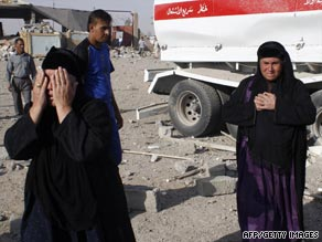 Iraqi women gather near the site of an attack in the village of al-Khazna, near Mosul, on Monday.