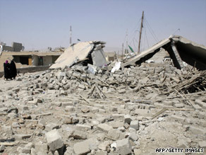 Houses are left in ruins earlier this week after truck bombings in the northern Iraqi village of al-Khazna.