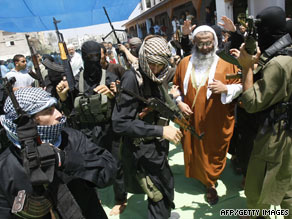 Armed members of the radical Islamist group Jund Ansar Allah gather in Rafah on Friday.