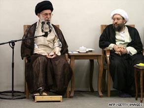 Ayatollah Ali Khamenei speaks during the announcement  that Sadeq Larijani, right, twill head Iran's judiciary.