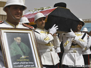 Iraqi honor guards carry the coffin of Shiite leader Abdul Aziz al-Hakim after it arrives Friday in Baghdad.