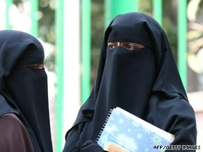 Cairo University students wearing niqab stand outside a university dormitory on Oct. 7