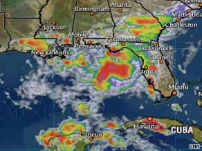 A satellite image from 6 p.m. ET Sunday shows a tropical storm nearing the Florida Panhandle.