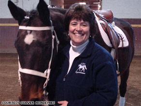 Lynn Rasch, Assistant Dean of Girls, Culver Academies with one a horse, Otis, of Culver Academies.