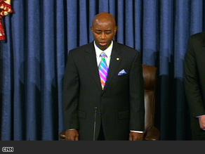 Senate chaplain Barry C. Black prays for Sen. Kennedy Tuesday.