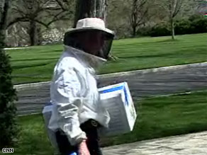 Beekeeper Charlie Brandts was dispatched Thursday to deal with a swarm of bees on the White House grounds.