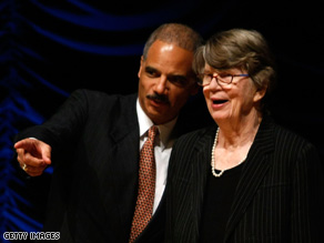 Attorney General Eric Holder helped honor Janet Reno, his former boss, Friday.