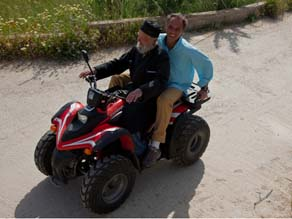Buettner gets a ride on one of the All-Terrain-Vehicles popular in Ikaria.