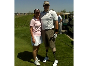 Kyra and her golf partner, Staff Sgt. Dale Beatty.