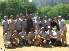 The American Morning staff softball players pose for a photo.