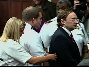 Christian Gerhartsreiter walks out of courtroom in handcuffs after guilty verdict.