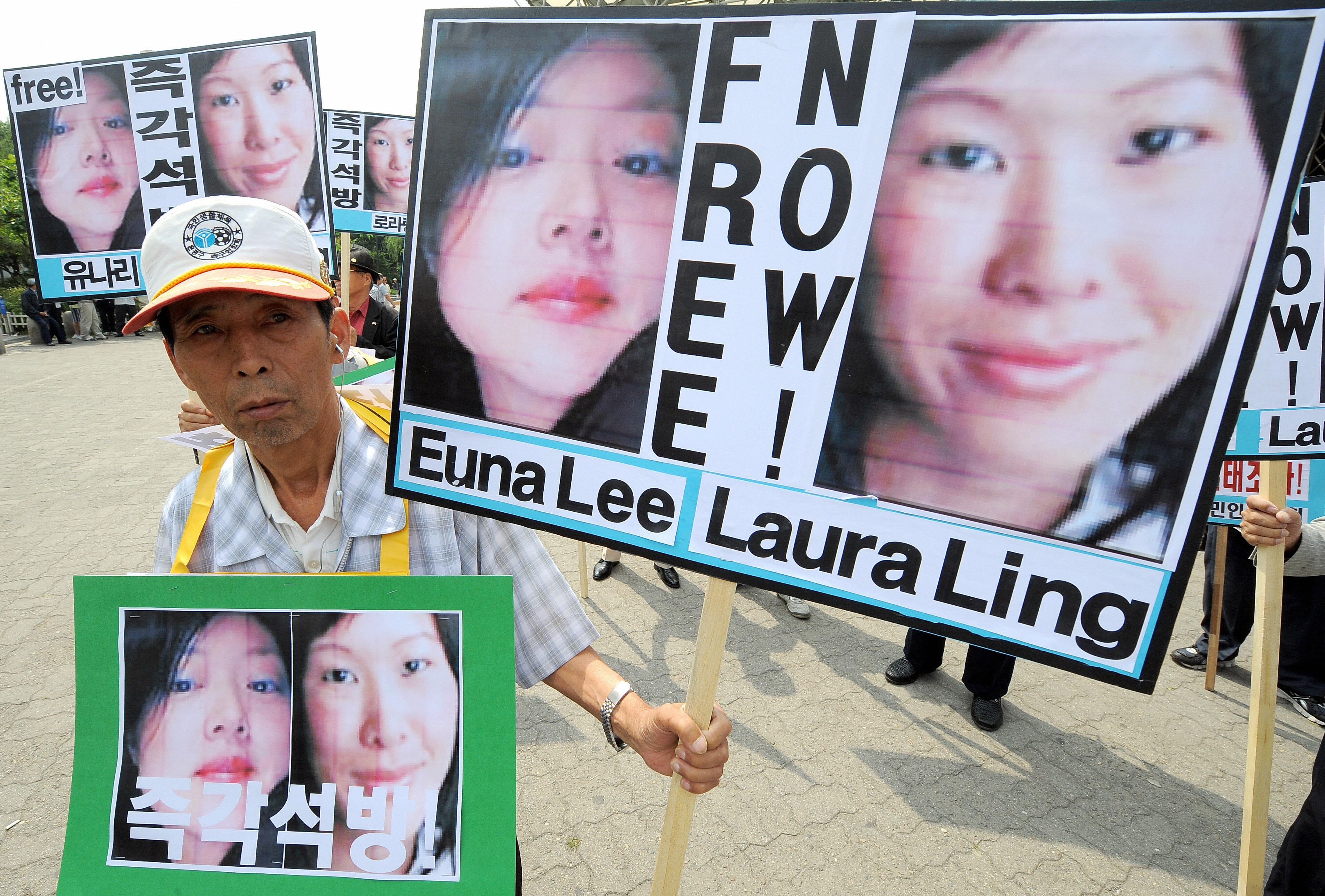 A South Korean activist holding pictures of U.S. journalists Euna Lee and Laura Ling