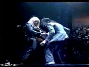 Michael Jackson rocking out with Orianthi during a rehearsal for his London comeback .
