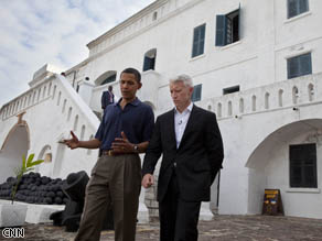 Anderson Cooper and President Obama walking around Cape Coast Castle.