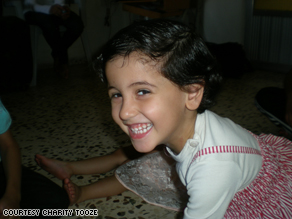 Neba Fahed, 4, laughs when company comes to visit her family in Jordan.