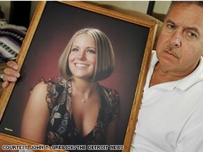 Steve Babcock holds a senior portrait of his daughter, Trisha Babcock, who was 24 when she was killed in Detroit on Aug. 1.
