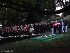 The Kennedy family gathers around the gravesite Saturday evening during the funeral for Sen. Ted Kennedy at Arlington National Cemetery.