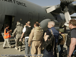 The crew boards a C130 at ISAF Kabul airbase.