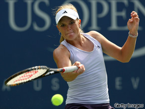 Melanie Oudin returns a shot against Nadia Petrova of Russia during day eight of the 2009 U.S. Open on September 7, 2009.