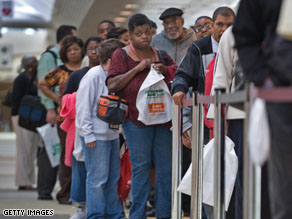 People seeking employment line up outside a job fair in Baltimore, Maryland.