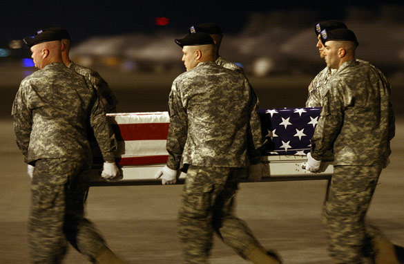 Image result for PHOTO OF PRESIDENT OBAMA AT DOVER AFB WITH RETURNING SOLDIERS IN CASKETS
