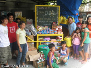Volunteers pack up bags of donated items like clothing and blankets to distribute to children and families in need in Cavite, Philippines.