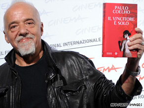 Paulo Coelho poses during a photocall for 'The Experimental Witch' Tuesday at the Rome Film Festival.