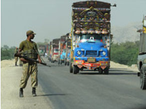 Pakistani soldier patrols military logistics route out of South Waziristan on October 24.