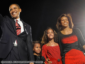 Barack Obama and his family arrive on stage for his election night victory rally at Grant Park in Chicago on November 4, 2008.