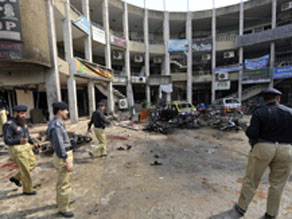 Pakistani policemen secure the site after a suicide bomb blast in Rawalpindi on Monday.