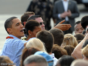 President Obama greets people after arriving in Hawaii on Thursday.